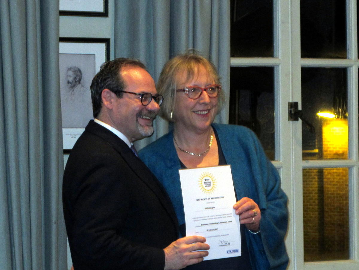 Jill McLauglin receives her prize from LTA CEO, Michael Downey